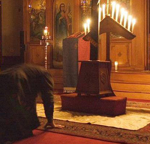 Bowing before the cross